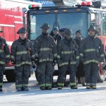 Firefighters line Western Avenue on Tuesday after the funeral of Edward Stringer. (E. Jason Wambsgans, Chicago Tribune / December 29, 2010)